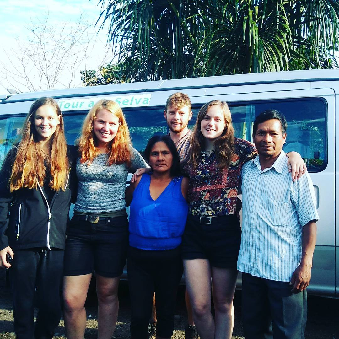 Volunteers with host family in south america
